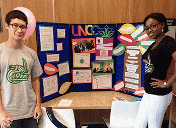 Students Travis and Tenielle with a display board